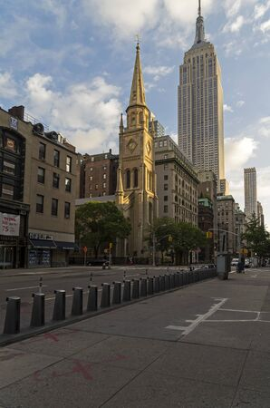 fifth avenue: The old Protestant church in the background Empire State Building. New York, Fifth Avenue, early morning. Editorial