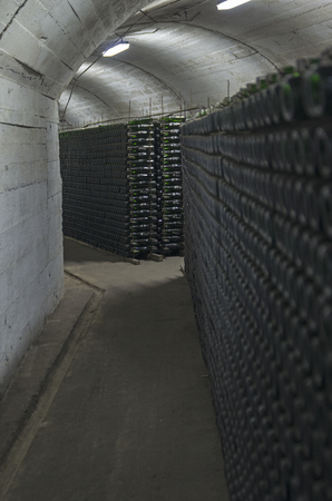 fermenting: Traditional technology of champagne production - fermentation of wine in bottles in underground tunnels. Crimea, factory of sparkling wines in Novyi Svit.