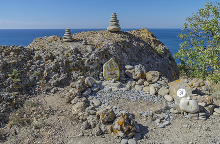 deities: Self-made makeshift altar of Hindu deities on the Black Sea. Crimea, Cape Meganom.