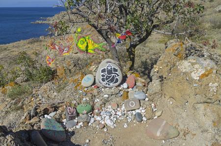 selfmade: Self-made makeshift altars to various deities on the Black Sea shore. Cape Meganom, Crimea, September. Stock Photo