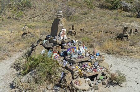 selfmade: Makeshift self-made  altar to god Shiva on the Black Sea shore. Cape Meganom. Crimea.