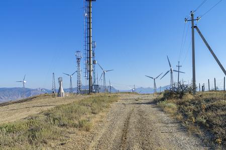 wind power plant: Dirt road leading to a wind power plant.. Crimea, Cape Meganom. Stock Photo