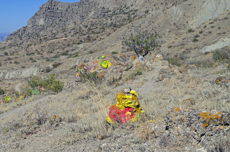 selfmade: Mountain slope with self-made makeshift altars various occult deities. Cape Meganom, Crimea, September.