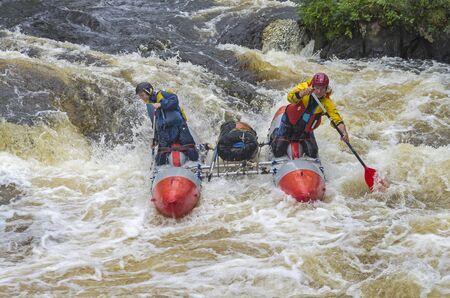 pista: PISTAYOKI RIVER, KARELIA, RUSSIA - AUGUST 5, 2015: Sport catamaran overcomes rapids.