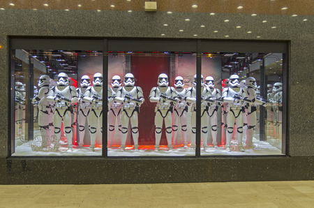 star: PARIS, FRANCE - NOVEMBER 18, 2015: Festive window dressing in Parisian department stores for Christmas. Star Wars storm troopers.