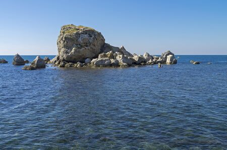 is cloudless: Small island. Calm sea and cloudless sky. Crimea. Stock Photo