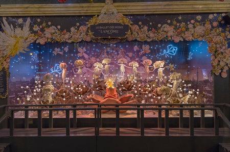 parisian scene: PARIS, FRANCE - NOVEMBER 16, 2015: Festive window dressing in Parisian department stores for Christmas. Fantastic scene - dancing of fairy roses