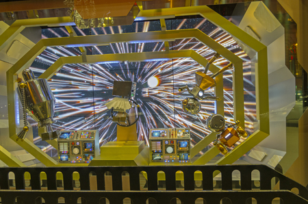 parisian scene: PARIS, FRANCE - NOVEMBER 18, 2015: Festive window dressing in Parisian department stores for Christmas. Fantastic scene - Robots in the command cabin of the spacecraft..