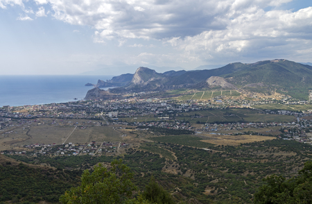 sudak: Panorama of the small resort town of Sudak from the top of the mountain Ai-George (or Saint George). Crimea, September.