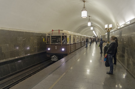 sub station: MOSCOW, RUSSIA - MAY 15, 2015: Retro train arrives at the Moscow metro station Park Kultury in the ring line. This train is a replica of the old trains used in the middle of the last century.