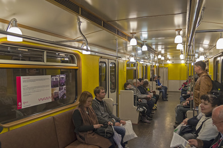 sub station: MOSCOW, RUSSIA - MAY 15, 2015: Interior of Moscow subway carriage. This train is a replica of the old trains that operated in the mid-20th century. Stock Photo