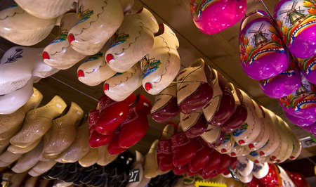 traditionary: Rows of the traditional Dutch wooden shoes klomps under the ceiling of the souvenur shop in the tourist village of Zaanse Schans near Amsterdam. Stock Photo