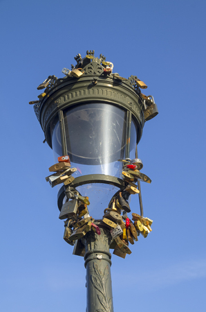 love proof: An old-fashioned lantern with love locks on a background of blue sky.