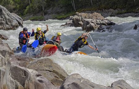 rapids: CHUYA RIVER, RUSSIA - AUGUST 7, 2014: Sports catamaran in a difficult rapids. River Chuya, Altai. Tourists call this rapids as Horizon