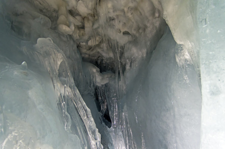 within: Bizarre icicles in natural caves in the thickness of the Hintertux Glacier. Austrian Alps, 3250 meters above sea level.