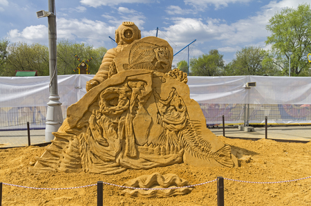 fish exhibition: MOSCOW,  RUSSIA - May 1, 2016: The exhibition contest of sand sculptures in Kolomenskoye Park. Composition The mystery of the ocean by Vadim Bondarec.