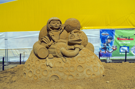 miles: MOSCOW, RUSSIA - May 1, 2016: The exhibition contest of sand sculptures in Kolomenskoye Park. Composition on cartoon Miles from Tomorrowland by Dmitry Baklamenko Editorial