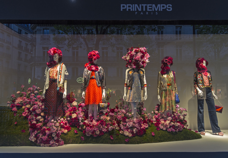 garb: PARIS, FRANCE - MAY 8, 2016: Mannequins in the showcase of a department store in Paris, France. Spring and summer theme.