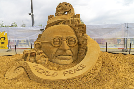 mahatma: MOSCOW,  RUSSIA - May 1, 2016: The exhibition of sand sculptures in Kolomenskoye Park. Composition The  dream of Mahatma Gandhi for world peace through non-violence by Sudarsan Pattnaik (India). Editorial