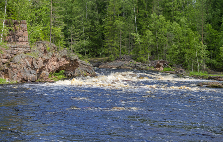 edifice: Rapids Edifice on Uksun river. June, the average water level. On the left - the remains of a ruined hydro power plant. South Karelia, Russia.