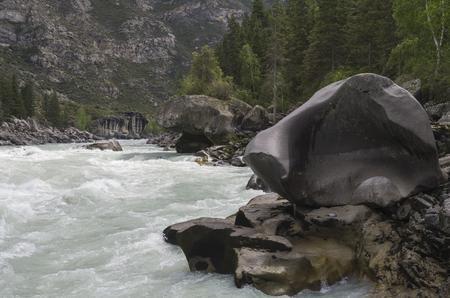 atlantes: Bizarre stone on the shore of a mountain river. Rapids Atlantes on the river Argut. Altai Mountains, Russia. Stock Photo