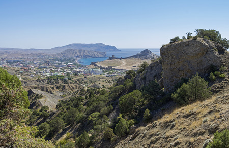 sudak: View of the city Sudak and Sudak Bay from the slopes of the surrounding mountains. Crimea, September. Stock Photo