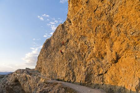 steep: Two climbers on a steep rock. Cape Alchak Crimea.