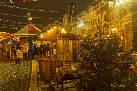 traditionary: MOSCOW, RUSSIA - DECEMBER 19, 2016: Large samovar on Red Square. Annual Christmas Fair. Moscow, Russia, December 2016. Editorial