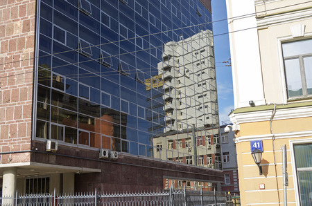 narrowly: Reflection of buildings in the glass wall. Myasnitskaya Street 391, Moscow, Russia.