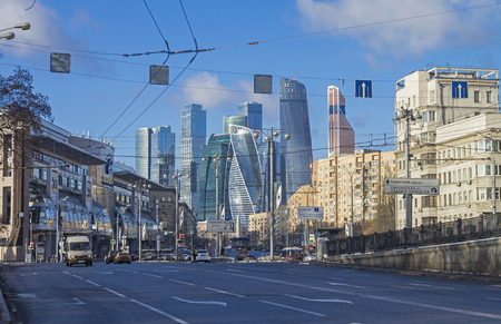 specular: MOSCOW, RUSSIA - JANUARY 21, 2017: View from Borodinsky bridge along the Bolshaya Dorogomilovskaya street toward the skyscrapers of the international business center Moscow-City. A combination of different architectural styles. Moscow, January, sunny day. Editorial