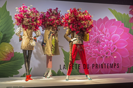 PARIS, FRANCE - MARCH 27, 2017: Mannequins in the showcase of the Printemps department store in Paris, France. Spring and summer theme.