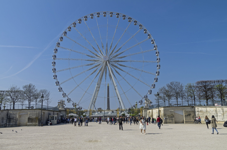 PARIS, FRANCE - MARCH 26, 2017:  Ferris wheel at the Place de la Concorde in Paris. A sunny day in the end of March