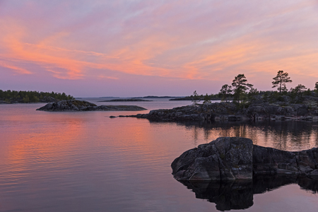 Sunset in the Ladoga Skerries, Karelia, Russia. June, the time of the white nights. Stock Photo
