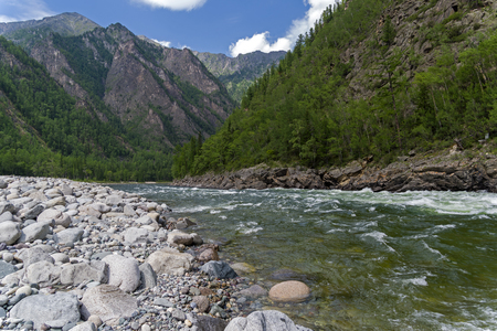 The Oka Sayanskaya River in the Orkho-Bom gorge. The  Buryatskiy rapids. Sunny summer day. Buryatia, Siberia, Russia.