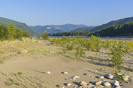 The Oka Sayanskaya River valley after the gorge of Orkho-Bom. Sunny morning in early August. Irkutsk region, Siberia, Russia. Stock Photo