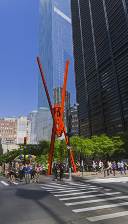 NEW YORK CITY - AUGUST 24, 2017: Manhattan, New York. Sculpture Joy of Life (Joie de Vivre) in Zucotti Park. Intersection of Broadway and Cedar Street. Sunny summer day.