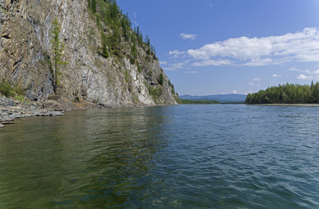 The Oka Sayanskaya River in the Orkho-Bom gorge. Sunny summer day. Buryatia, Siberia, Russia.