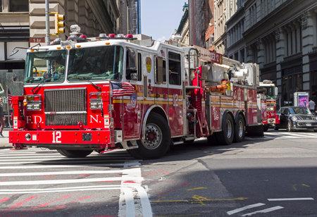 NEW YORK CITY - AUGUST 24, 2017:  A big red fire truck in Manhattan.  New York, USA.