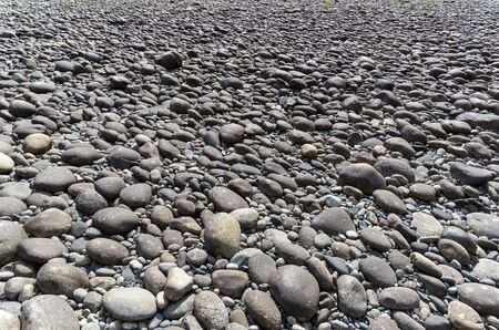 The background formed by a large gray pebble on the river bank. Imagens