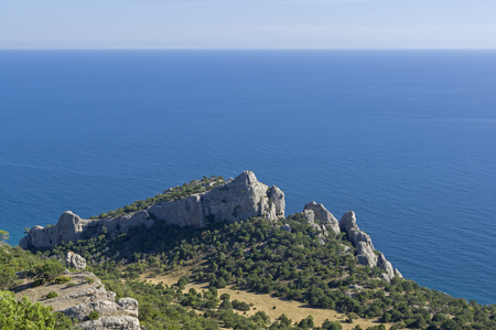 Crimea. Natural sights of the Novyy Svet. View from the top of the Karaul-Oba to the Cosmos Peak and the Paradise Valley. Sunny summer day.