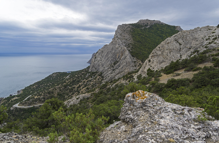Mountains on the Black Sea coast between Sudak and Novyy Svet, Crimea. Cloudy day in late August. Stock Photo