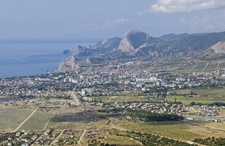 View from the top of Mount Ay-George to the resort town of Sudak. Black Sea coast of Crimea. September. Stock Photo