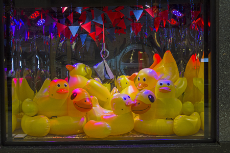 PARIS, FRANCE - DECEMBER 12, 2017: Inflatable ducks in the shop window of the Parisian Galeries Lafayette department store. Decoration of shop windows for Christmas and New Year.