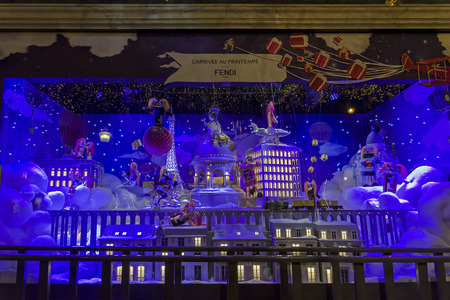 PARIS, FRANCE - DECEMBER 12, 2017: Christmas decorations in the shop window of a Parisian Printemps department store.  Fantastic view of the night city.  Editorial