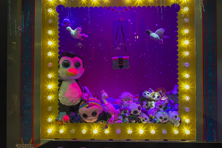 PARIS, FRANCE - DECEMBER 12, 2017: Christmas decorations in the shop window of a Parisian Galeries Lafayett department store. Stuffed Toys.  Editorial