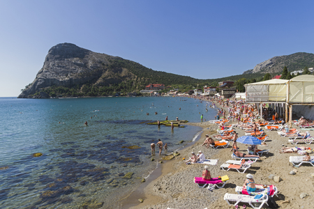 Beach in the bay of the village of Novy Svet. Sunny summer day, Crimea.