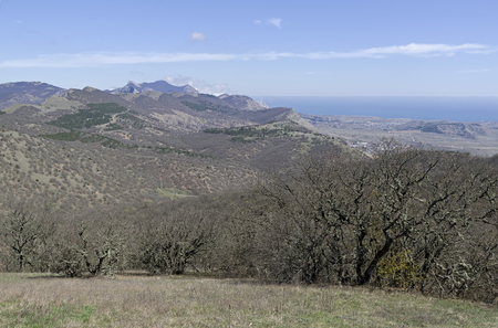 View from the slope of the Tokluk-Syrt ridge towards the sea. Crimea, spring, early April. Sunny day.
