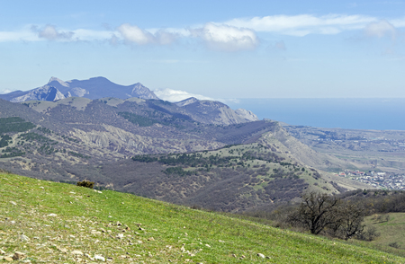 View of the surrounding mountains from the top of the mountain Ai-Georgiy (Manjil), the western tip of the Tokluk-Syrt ridge. Crimea, spring, early April. Sunny day.