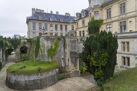 Decorative moat in at the  castle Castle Fortress, Grand Mello, France. Cloudy day in August.