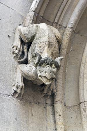Gargoyles on the wall of a medieval building. Rouen, France.